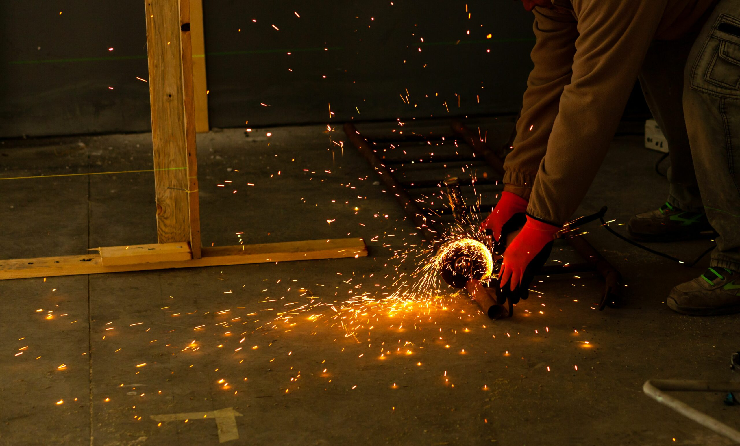 worker-using-the-grinder-many-sparks-for-iron-cutting